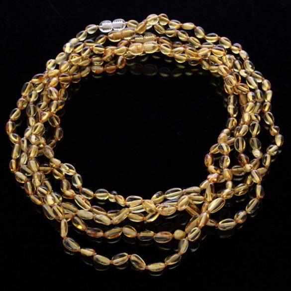 Borostyán nyaklánc, csiszolt, 8-11x6x5 mm, babszem forma, mézszínű, 46 cm